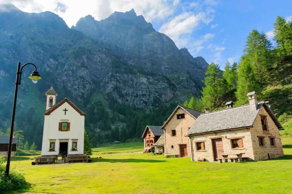 three houses near chapel below valley